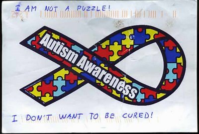 The picture is of a postcard with the Autism Ribbon and under it, it says I DON'T WANT TO BE CURED